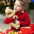 Beautiful little girl with cristmas present — Stock Photo