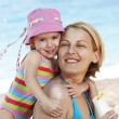 Mother and daughter having fun on the beach — Stock Photo