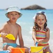 Children playing on the beach — Stock Photo