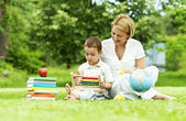 Learning in the park. mother and son — Stok fotoğraf