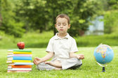 Beautiful child in zen meditation in park — Stock Photo