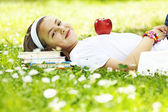 Teenage girl resting in meadow — Stock Photo
