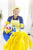 Cleaning woman pointing with mop — Stock Photo