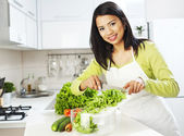 Smiling woman preparing salad — Stock Photo