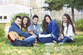 Two teenagers resting in the park — Stock Photo