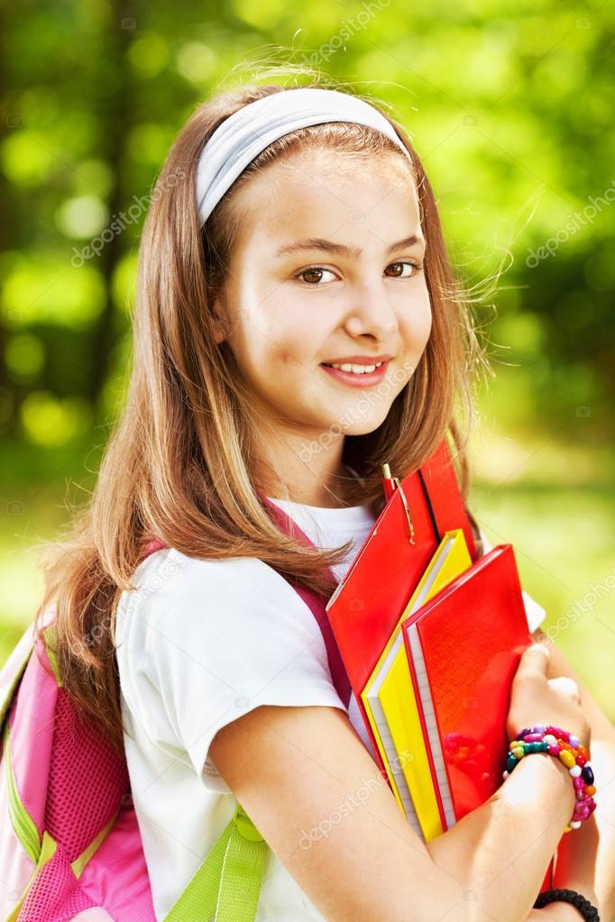 Beautiful teenage girl holding books stock photo dejan for Teenage beautiful girls