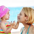Daughter Protecting Mom of the sun — Stock Photo #32590527