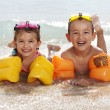 Children lying on the beach — Stock Photo