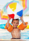 Boy smiling and playing with ball — Stock Photo