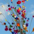 Branches of the tissue paper flowers, different colors of flowers. — Stock Photo #27453495