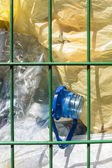 Trash basket with plastic bottles and bags visible. — Stock Photo