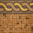Mosaic in ancient style stacked with tiny brown, yellow, blue tiles. — Stock Photo