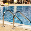 Постер, плакат: Edge of swimming pool Barriers to exit the pool