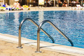 Edge of swimming pool. Barriers to exit the pool. — Stock Photo