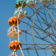 Ferris wheel with carriages in different colors. — Photo