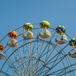 Ferris wheel with carriages in different colors. — Stock Photo