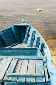 Blue wooden rowing boat. — Stock Photo