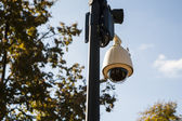 Security camera on pole set to the observations of the street and people. — Stock Photo
