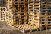 Wooden transport pallets in stacks ready for delivery. — Stock Photo