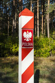 Border post with the emblem of the Polish. — Stock Photo