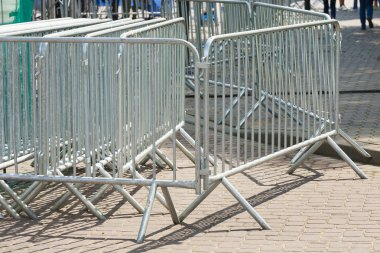Metal barriers separating people at the concert.