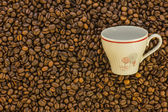 Coffe grains with coffee cup — Foto de Stock
