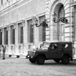 Military car in front of building in Rome — Stock Photo #36115681