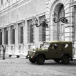 Military car in front of building in Rome — Stock Photo #36115709