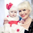 Grandmother with granddaughter — Stock Photo #28428785