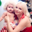 Christmas baby girl with blond hair mother — Stock Photo #28992115