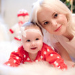 Christmas baby girl with blond hair mother — Stock Photo #28992135