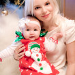 Christmas baby with snowman dress and mother — Stock Photo #28992455