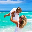 Mother and daughter are having fun at the beach — Stock Photo