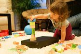 Baby is playing with wooden blocks — Stock Photo