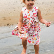 Little two year old girl at the beach — Stock Photo