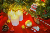 Christmas ornament and candles — Stock Photo