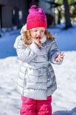 Cute baby girl enjoying first snow — Stock Photo