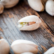Stock Photo: Close-up of roasted pistachios on wooden background