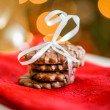 Chocolate cookies on white textile with ribbons — Stock Photo