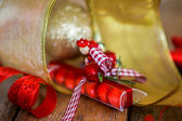 Christmas red sweets with golden ornaments — Stock Photo