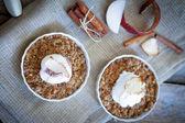 Apple crumble dessert with cinnamon and vanilla ice -cream on wooden background — Stock Photo