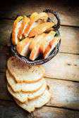 Sliced fresh bread on wooden background,vintage — Stock Photo