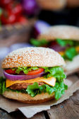 Closeup of home made burgers on wooden background — Stock Photo