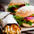Closeup of home made burgers on wooden background — Stock Photo #39190691