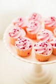 Cupcakes with pink cream and heart sprinkles — Foto Stock