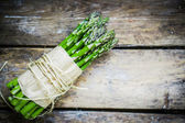 Asparagus on rustic wooden background — Stock Photo