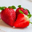Stock Photo: Closeup of strawberries on wooden backgorund