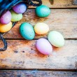 Easter eggs in the basket on rustic wooden background — Stock Photo #40990027