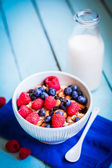 Granola with berries and almonds in a bowl — Stock Photo