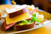 Club sandwich with ham and cheese — Stock Photo
